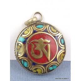 Pendentif orné du Om tibétain couleur corail Bijoux tibetains bouddhistes  ABT24.2